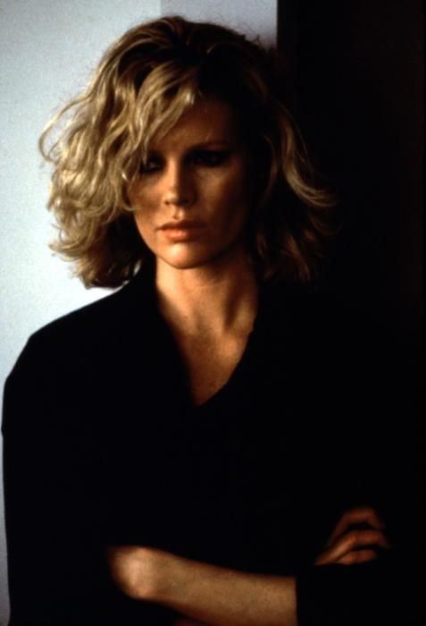 Absolutely love Kim Basinger's hair and clothes in '9 1/2 Weeks'.  Not a good movie...but great style.
