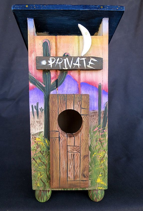 Yup - thats right! Heres a birdhouse designed as an outhouse. I have kept its wooden door like a weathered old door and turned that rest of that old outhouse into the whole outdoors - a veritable Southwestern Desert visible on every side. WHAT a conversation piece! Theres cactus, arroyos, the sun and stars on the roof, everything you need for a desert setting. This is an original, one of a kind birdhouse painted by me. You will enjoy it for years to come...your own unique treasure. This 10 H…