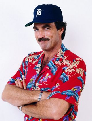 The classic Magnum PI, Tom Selleck, cap, hawaiian shirt, colorful, gesture, great guy, tv series, dear memories, photo.