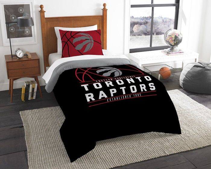 Toronto Raptors NBA Reverse Slam Twin Comforter and Sham Set. Includes 1 Sham and 1 Twin Comforter. Visit SportsFansPlus.com for Details.
