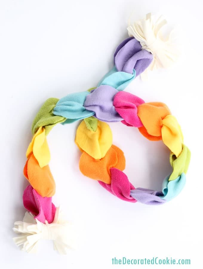 """This no-sew rainbow scarf is the perfect birthday or holiday gift kids can make! How-to video AND printable instructions below.  If I was like Oprah and had a bunch of """"Favorite Things"""" for holiday gift giving, this no-sew rainbow scarf would be at the top. Last year, my daughter and I made these for...Read More »"""