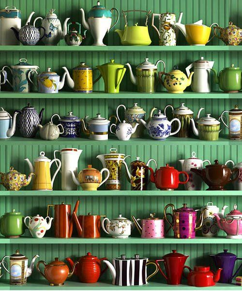 Teapot collection against green shelving