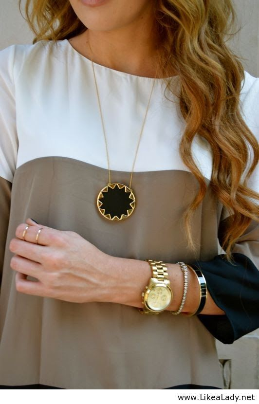 I love the necklace and the colors of the shirt...the fit would be too loose for me.