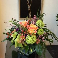 A Scented Flower Arrangement in Glass Vase for Mother's Day
