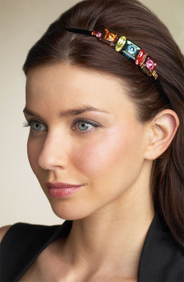 Long dark straight hair with a side part and a multi-colored jeweled headband