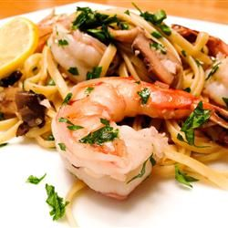 Shrimp Scampi with Pasta.  Made this for my Valentine! Wonderful, lemony and light. I did cut back on the butter and oil and used a little of the pasta water for more sauce.