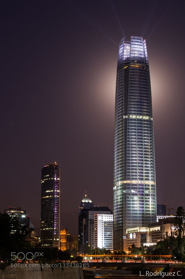 Moonlight Costanera Center Full moon right behind Costanera center. Couldn't get the shot I wanted of the moon but I got this one so I'm happy. Merry Christmas