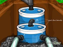 "Construct a Small Septic System with 2 55gal drums and 40+ feet of 4"" pipe"