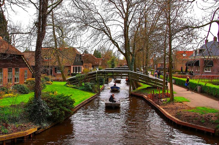 """Giethoorn, Netherlands - """"This idyllic Dutch village, once known as the """"Venice of the North,"""" has little canals instead of roads, making the land around each house its own little private island."""""""