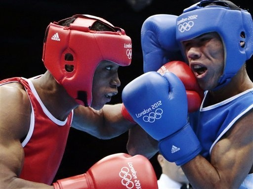 http://www.MilitaryGradeNutritionals.com/blog  Wellington Arias Romero of the Dominican Republic lands a punch against Colombia's Eduar Marriaga Campo during men's light 60-kg boxing at the 2012 Summer Olympics in London.