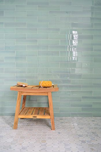 Fool proof shower tile combo: light blue glass tile with marble on the floor