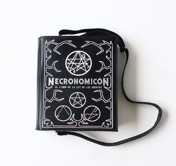 This bag is made by hand in a shape of a book in black, white and silver colors. Necronomicon.  = Exterior = Made of genuine black and beige