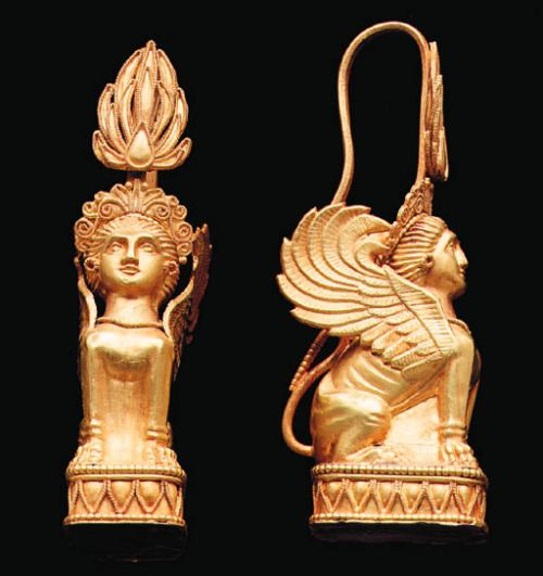 """Greek Gold Sphinx Earrings, 4th Century BCOriginally an Egyptian mythological creature, the sphinx was adapted by the Greeks and appears frequently in Greek art. In some versions of Greek mythology, the sphinx was the offspring of the monster Echidna (half nymph and half snake) and Orthos (the hound of Geryon). The Greek sphinx (which means strangler) became famous for the tale of """"The Riddle of the Sphinx"""". There are several versions of this story but the most recounted (and shortest…"""