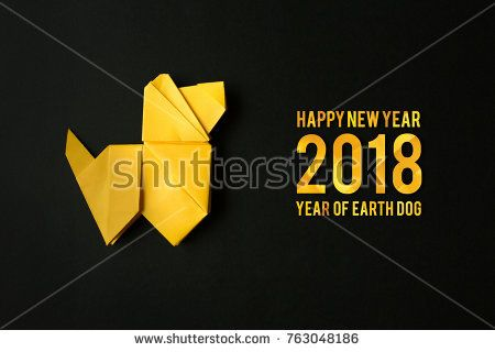 Yellow folded origami dog on red paper background. Horizontal holiday postcard, poster, banner template. Happy New Year 2018 greeting, text, letters.