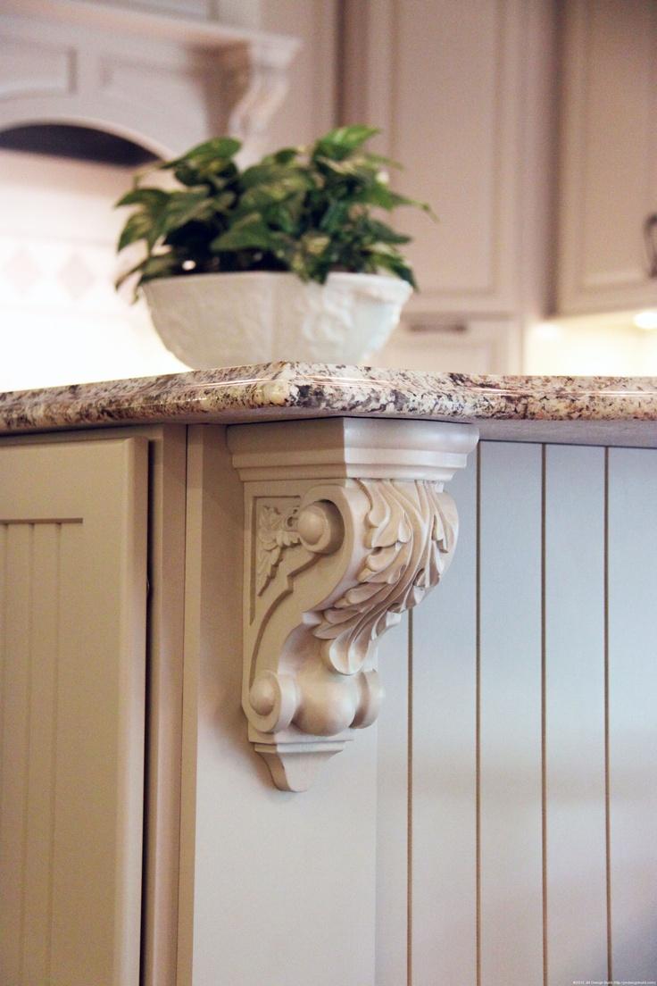Kitchen Remodel Bainbridge, Oh/ Crown Molding Detail on White Cabinets/ Unique Kitchen Island with Granite Counter Top | JM Design Build