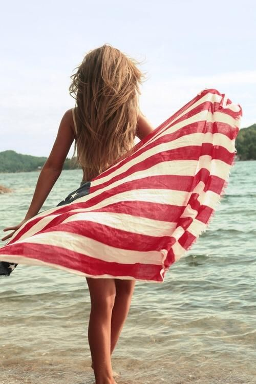 A beautiful american girl with american flag, sun and fun :)