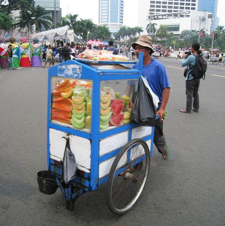 Travelling fruit rujak and fresh fruit vendor, Jakarta, Indonesia.