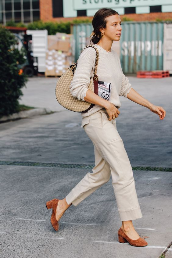 Stylish in casual nude trousers and jumper with camel accessories