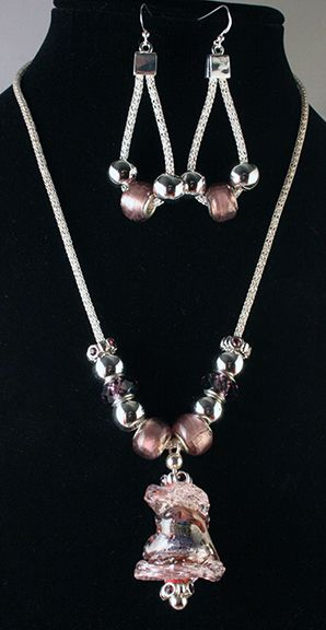 Pandora style with handmade lampwork pendant. Silver plated omega chain with glass beads.