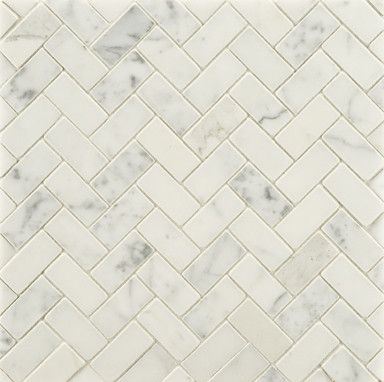 Statuary Stone Mosaic - traditional - bathroom tile - other metro - Rebekah Zaveloff    Statuary is often misinterpreted for Calacatta or Carrara marble. It's got more gray than Calacatta and a whiter background that Carrara. Beautiful here as a mini-herringbone and would look great as a bathroom floor or behind a stove in a kitchen.