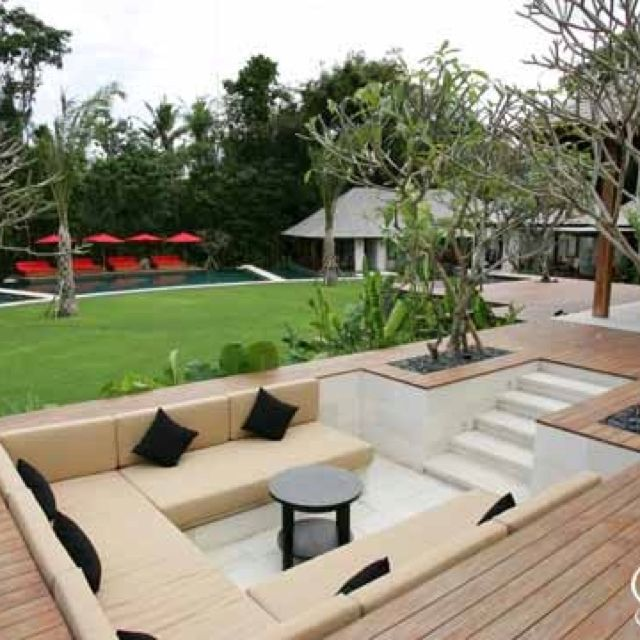 Sunken cabana with throw cushions at end of garden - Gardening Timing