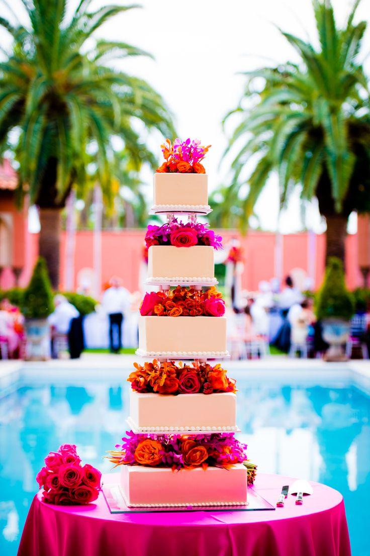 A bold floral wedding cake for a tropical destination wedding