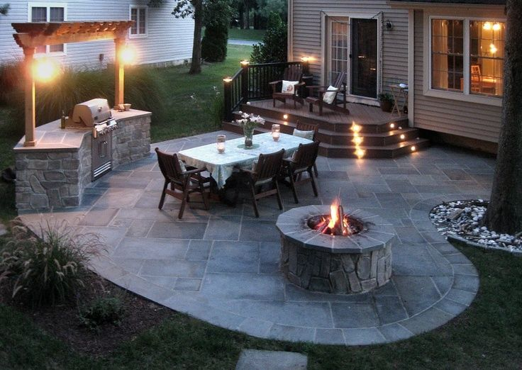 Minus the terrible stove thing, and a nicer looking fire pit, perhaps with a low wall along the out side of the patio.  But like the graduated steps from the back door on to the stone.
