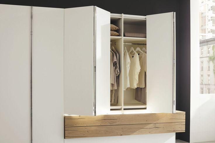 Moderne Kleiderschrank / lackiertes Holz / aus Massivholz / Falttüren - GENTIS - hülsta - Videos