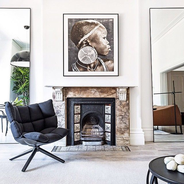 A contemporary terrace apartment by interior designer Pamela Makin provides a effortlessly peaceful haven right in the heart of beautiful Sydney. The designer's deft layering of black and white, modern and primitive, creates timeless interiors of purist calm and luxury. I am completely obsessed with that gorgeous Jan Schlegel native print above the fireplace and love how the contrasting B&B Italia Husk Chair by Patricia Urquiola complements all the earthy elements. #meandmybentley