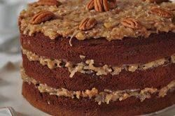 This beautiful German Chocolate Cake has three moist layers of chocolate cake, with a sweet and gooey caramel frosting, laced with coconut and pecans. From Joyofbaking.com With Demo Video