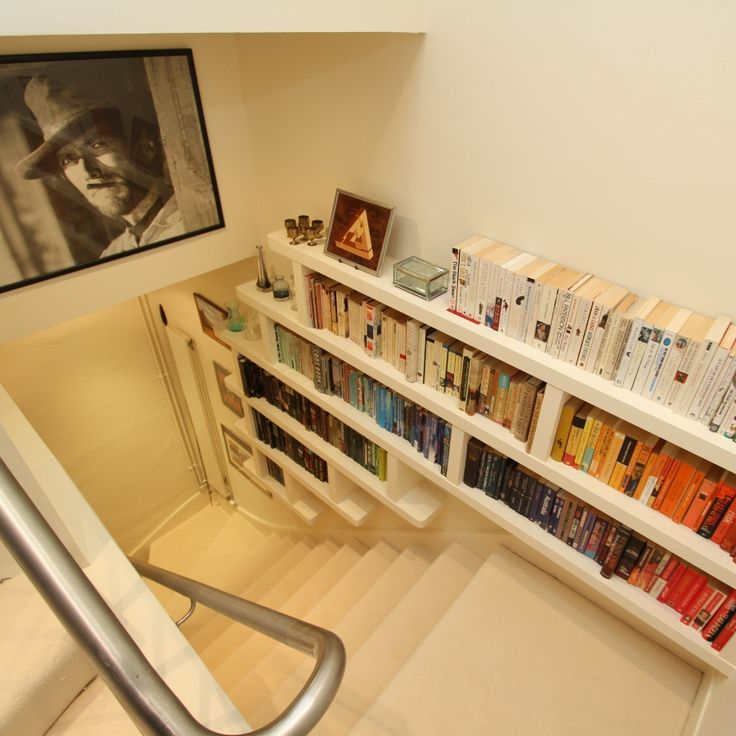 Stairway floating shelving  Bespoke fitted shelving designed by Tristan Titeux and made by www.CustomCarpentry.co.uk