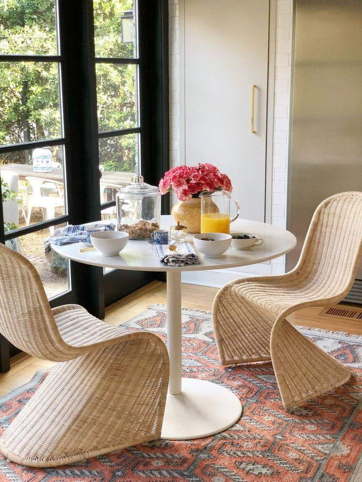 set of 2 rattan dining chairs , similar flatweave rug
