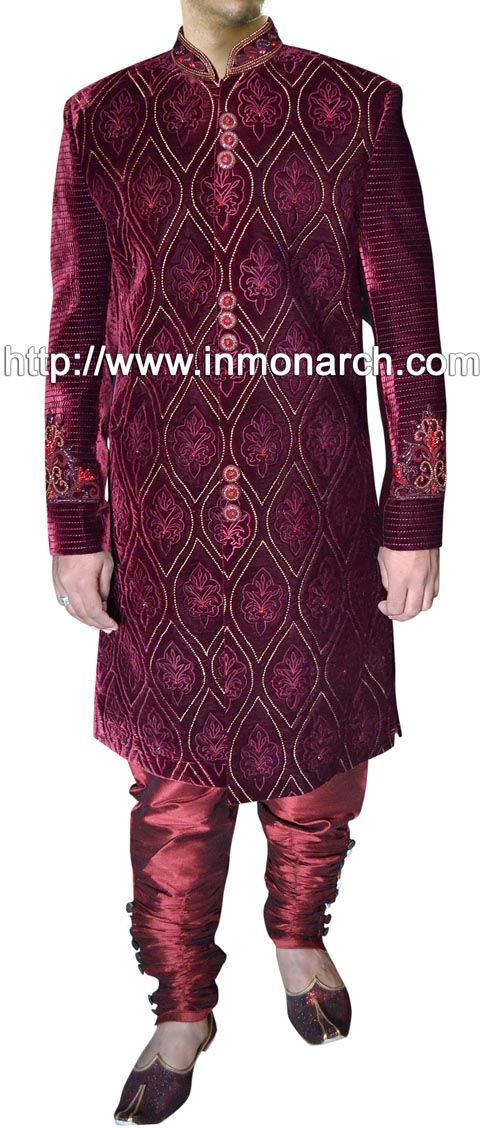 Fashionable look sherwani made from maroon color velvet fabric. Hand embroidered as shown. It has bottom as matching chudidar.
