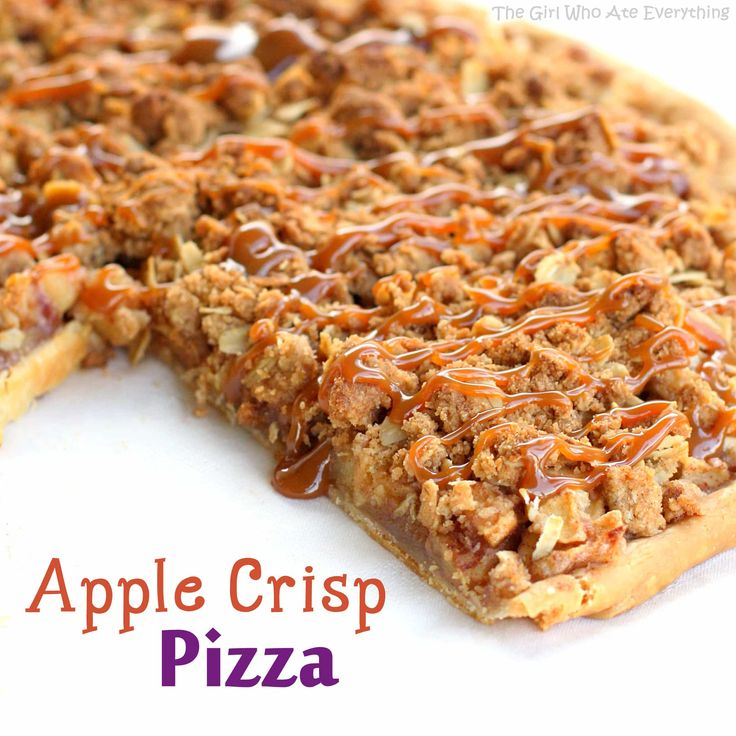 This Apple Crisp Pizza has cinnamon sugared apples piled on top of a flaky pie crust and drizzled with caramel sauce. the-girl-who-ate-everything.com