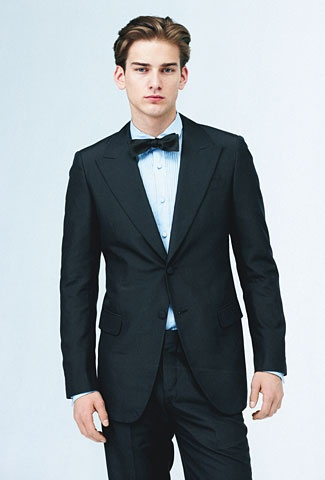 Tuxedo and shirt by Prada. Bow tie by Brooks Brothers.