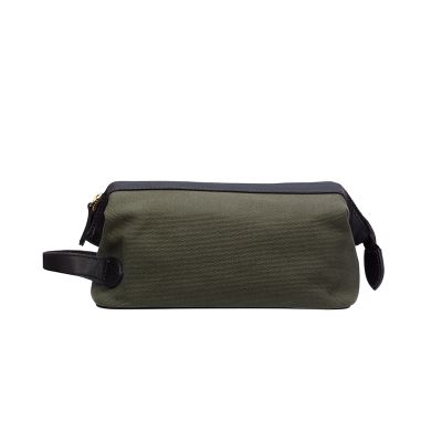 BARON  TOILET BAG  €75  This is a practical and stylish toilet bag from Baron and is made of water-repellent canvas and has details in waxed leather. There is a main compartment and an inside pocket with zipper.
