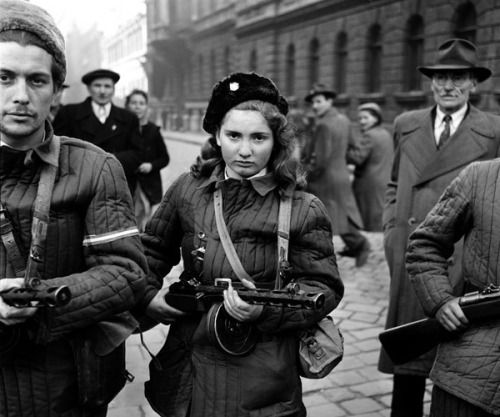""""""" Erika, 15, a Hungarian Freedom Fighter, carries a machine gun in Budapest during the revolution, 1956, she was eventually shot by the Soviets """""""