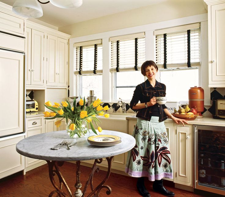 An English Love Affair 1 of 11 - Traditional Home® - Black cloth tape on white wood blinds makes this a special kitchen.