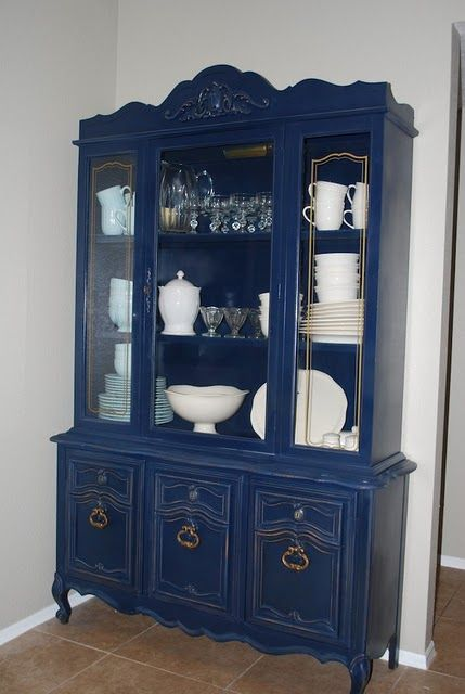 Navy China Cabinet Makeover - love that the white dishes pop against the navy!
