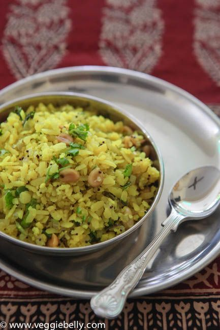 Quick Poha Recipe (breakfast dish of Maharashtra state) from VeggieBelly: 2 cups thick (mota) poha, rinsed & drained for no more than 10 min; In 2 tablespoons oil, heat 1/2 teaspoon black mustard seeds + 3 tablespoons peanuts + 1/2 cup minced onion (about 1 medium onion) + 6 curry leaves. Add 1 green chili, minced; 1/2 cup boiled, peeled, cubed potato or frozen green peas (both are optional); 1/2 teaspoon turmeric powder; 1 teaspoon lime juice. Heat thru.