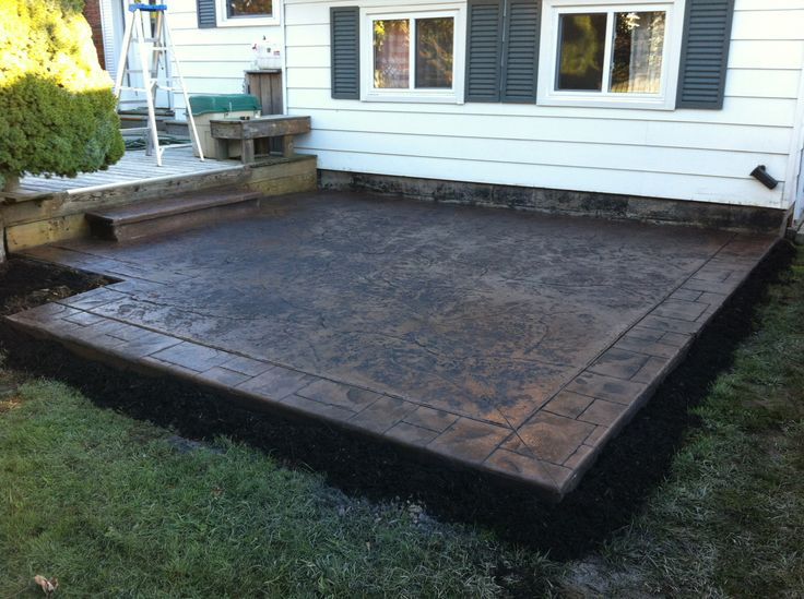 Rough Cut Stone Stamped Concrete Patio With Small Ashlar