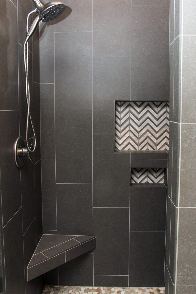 Dark Gray Tiled Shower With White And Chevron Tile Accent Niche