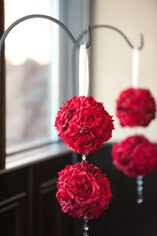 Red roses hanging from sheep's hooks