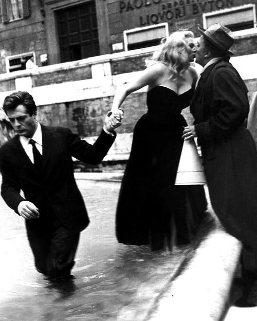 Marcello Mastroiannni, Anita Ekberg, and Federico Fellini during the filming of La Dolce Vita (1960).