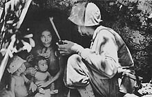Battle of Saipan - A Marine talks a terrified Chamorro woman and her children into abandoning their refuge