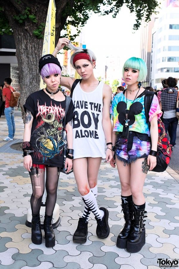 Chamii with Miho & Maho (the twins) on the street in Harajuku. We see these three together often in Tokyo, and they always turn heads with their androgynous Boy London-heavy styles. Check all of their snaps for lots more details here: http://tokyofashion.com/miho-maho-chamii-boy-london-harajuku/