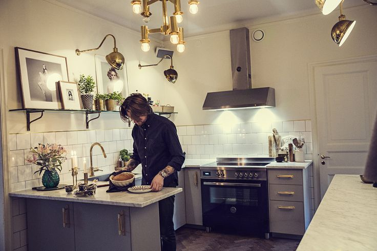 The Way We Play Magazine - Dusty Deco founder Edin Memic Kjellvertz - Kitchen with grey cabinets, marble, white tile and brass details.