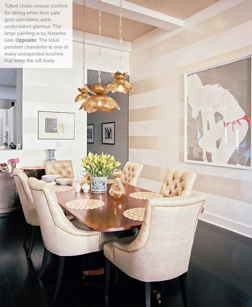 Love the shiny striped walls, the upholstered chairs, and the flower pendant #lighting in this #diningroom. That blush color on the ceiling really pulls it all together, too.