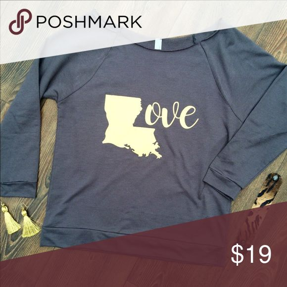 Love Louisiana Slouchy Top This adorable lightweight terry sweatshirt is super comfortable and luxurious. It's large boat neck has raw edges for an extra cute detail. It has 3/4 length sleeves with Love and the L in the shape of Louisiana in gold.    Small- Chest 38, Front Length 24.5   Care Instructions- Handwash or delicate cycle, inside out, on cold. Hang dry for best results. Do not iron on screen Tops Sweatshirts & Hoodies