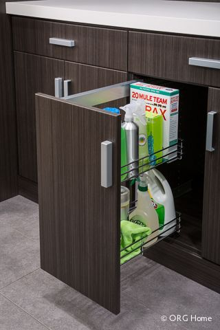 Pull-out cabinet baskets Bottles, boxes, and even the iron are stored neatly out of sight within the sturdy, easy-to-clean wire baskets. Adjustable positions let you hold supplies easily, and a soft, silent open/close eliminates needless noise.